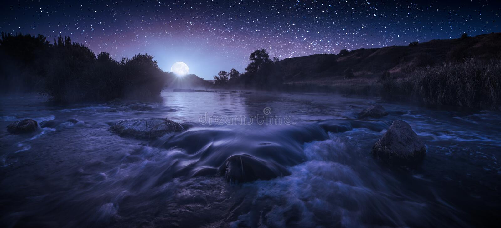 Beautiful starry night above the river stock photos