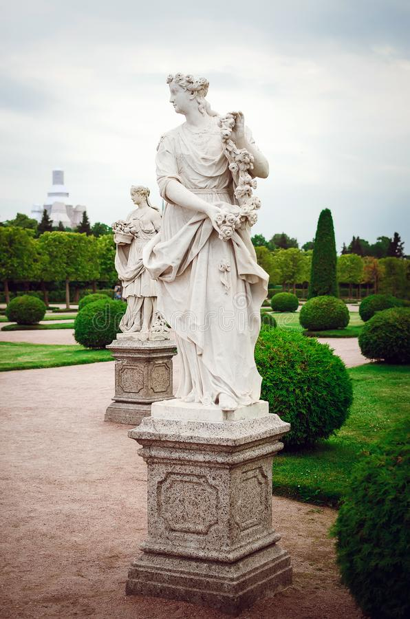 Saint Petersburg, RUSSIA - July 11, 2018: Beautiful statues in park of rest in Peterhof in St. Petersburg. Attractions for royalty free stock image