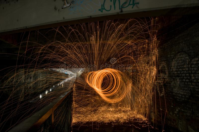 Beautiful steel wool light effect in a painting with unique patterns at nighttime in Milan, Italy. A beautiful steel wool light effect in a painting with unique stock photo