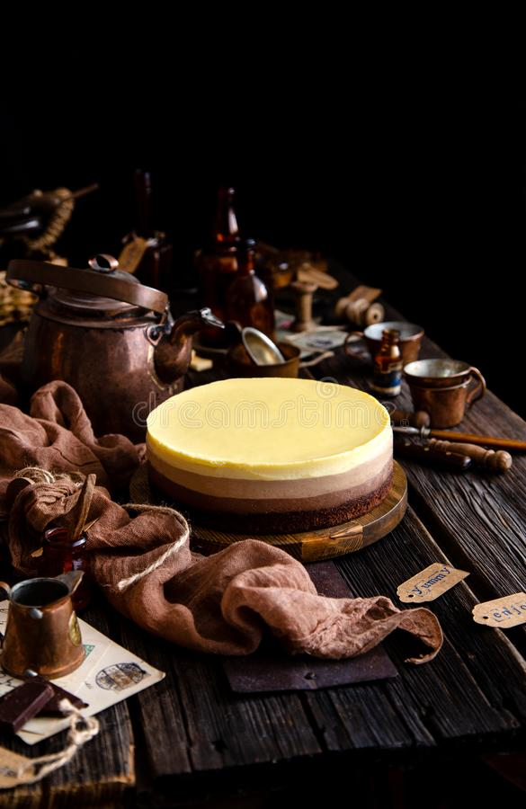Free Beautiful Still Life With Homemade Delicious Three Chocolates Cheese Cake On Wooden Stand On Rustic Table Stock Photography - 155512632