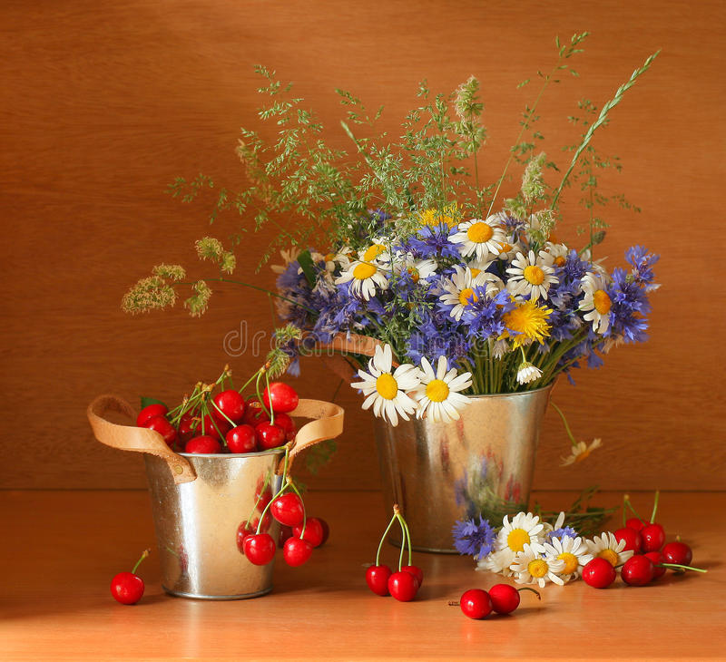 Beautiful stillife with cherries. And fresh flowers stock photos