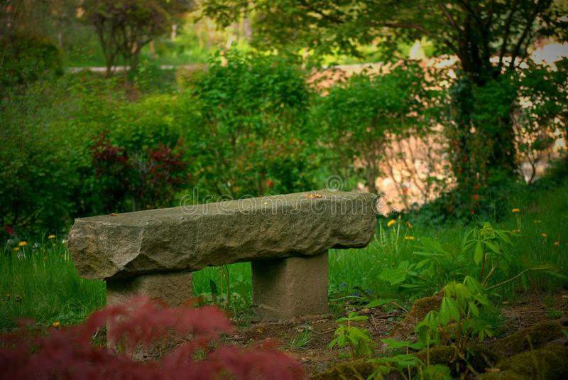 Japan Garden Mu-Shin. Beautiful stone statue of seat in japan garden. Peaceful place in park royalty free stock photography