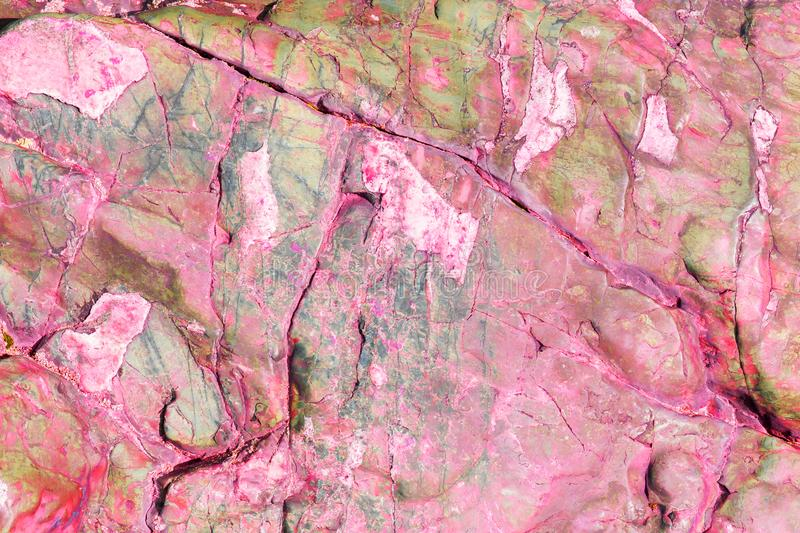 Beautiful stone texture with pink and green hues. Abstract background stock photography