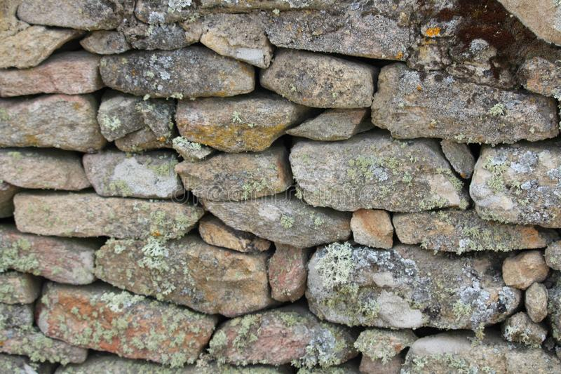 Beautiful stone wall, hand-made and very old royalty free stock images