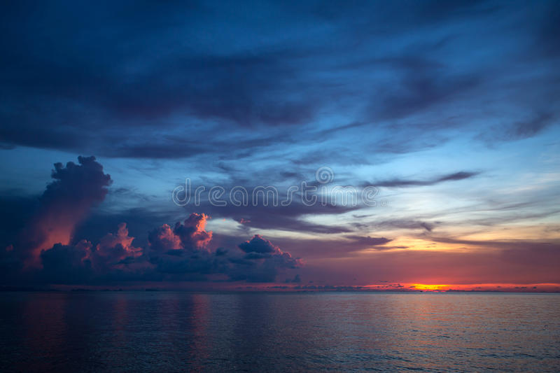 Beautiful storm clouds at the sunset. Over the sea stock images