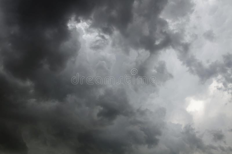 Beautiful storm sky with clouds. Apocalypse, tunder, tornado. Black clouds is coming down stock images