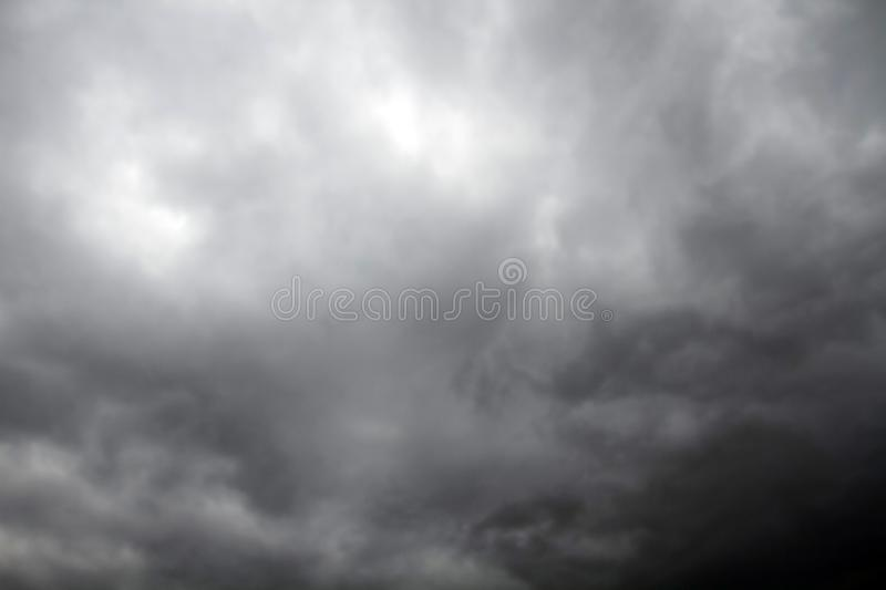 Beautiful storm sky with clouds. Apocalypse, tunder, tornado. Black clouds is coming down stock image