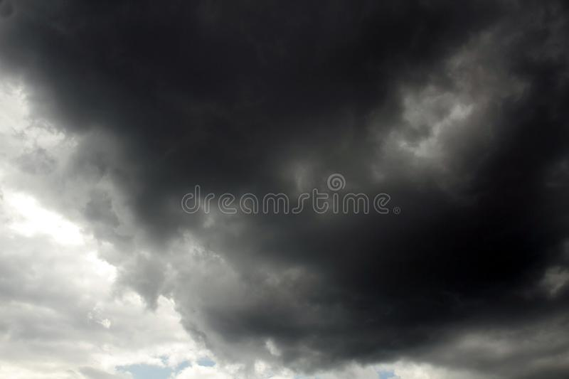 Beautiful storm sky with clouds. Apocalypse, tunder, tornado. Black clouds is coming down stock photo
