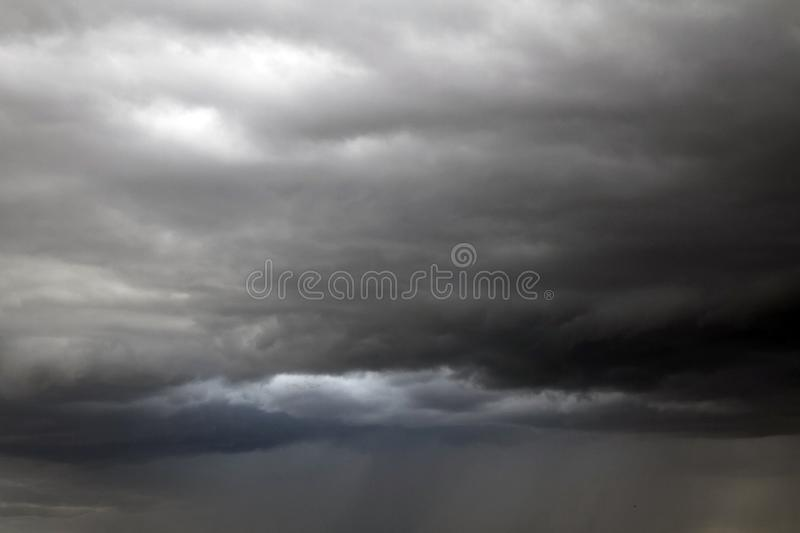 Beautiful storm sky with clouds. Apocalypse, tunder, tornado. Black clouds is coming down stock photos