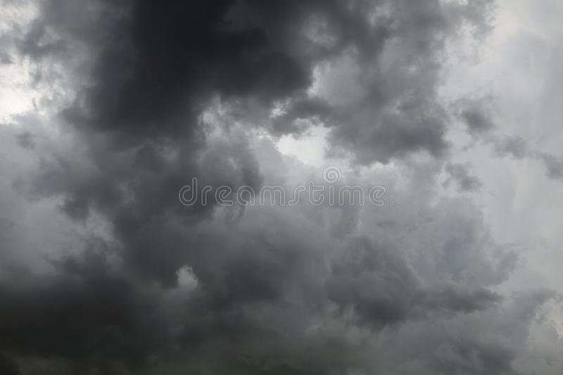 Beautiful storm sky with clouds. Apocalypse, tunder, tornado. Black clouds is coming down royalty free stock photo