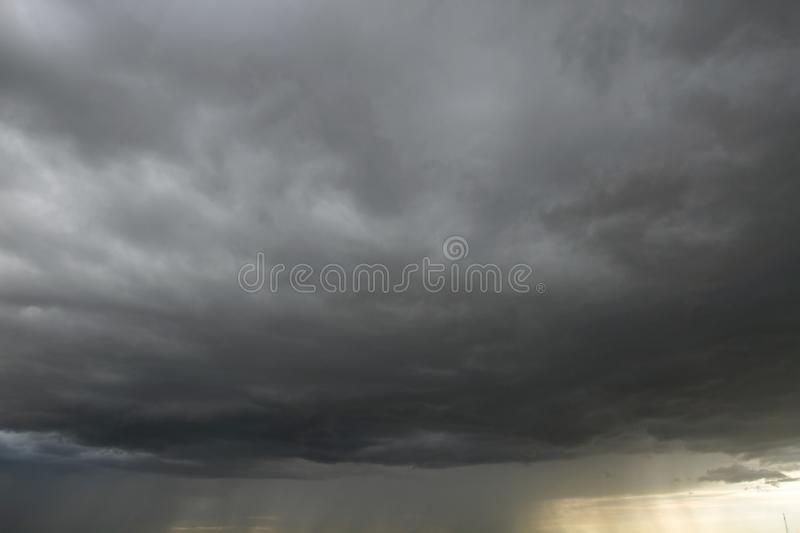 Beautiful storm sky with clouds. Apocalypse, tunder, tornado. Black clouds is coming down royalty free stock image