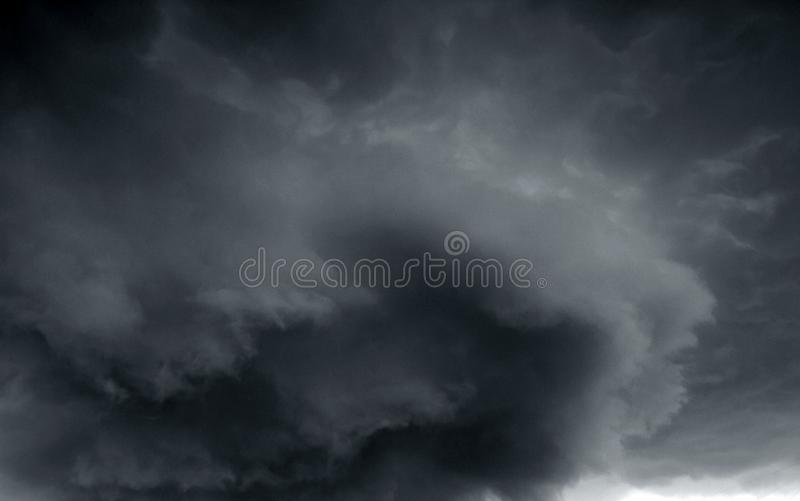 Beautiful storm sky with clouds. Apocalypse, tunder, tornado. Black clouds is coming down royalty free stock photos
