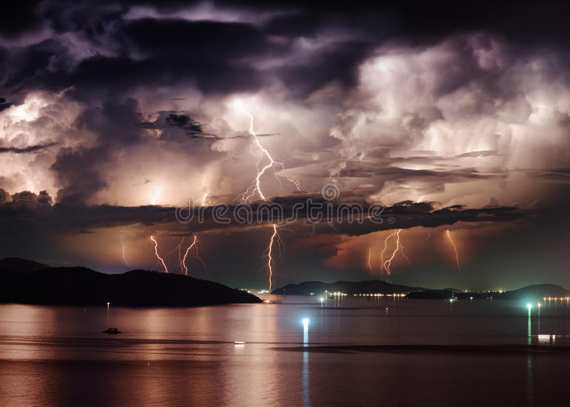 Beautiful stormy sky and lightning over Nha Trang Bay, Vietnam. Beautiful view of dramatic stormy sky and lightning over Nha Trang Bay of South China Sea in royalty free stock photo