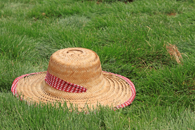 Beautiful straw hat. In the green lawn stock photos