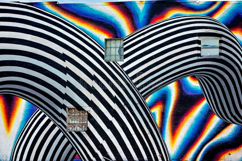 Beautiful street art of graffiti. Abstract color creative drawing fashion on walls of city. Urban contemporary culture. stock images