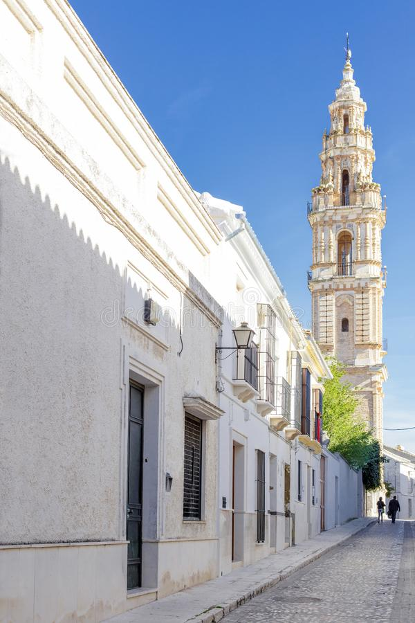 Beautiful Street in Estepa province of Seville with Tower of Victory in the background. Charming white village in Andalusia. Southern Spain. Picturesque travel stock images
