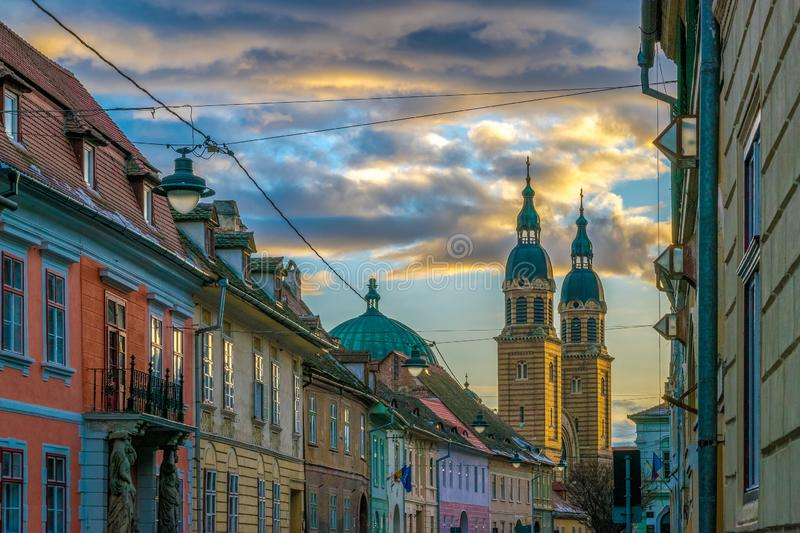 A beautiful street and Holy Trinity Cathedral at sunset in Sibiu, Romania stock images