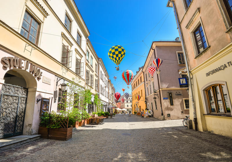 Beautiful street and old bright buildings in the old town of Lublin, Poland. stock photo