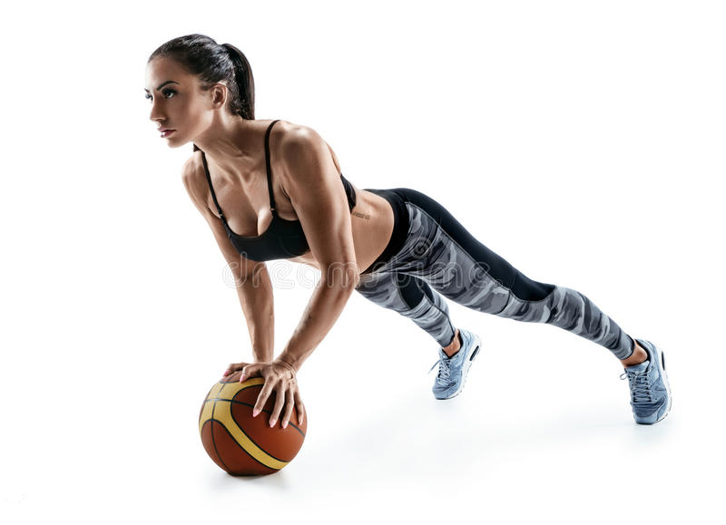 Beautiful strong woman doing push up on ball isolated on a white background. stock image