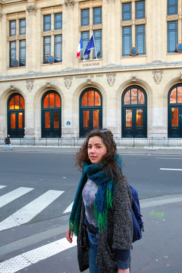 Beautiful student girl on background of the Sorbonne University in Paris stock images