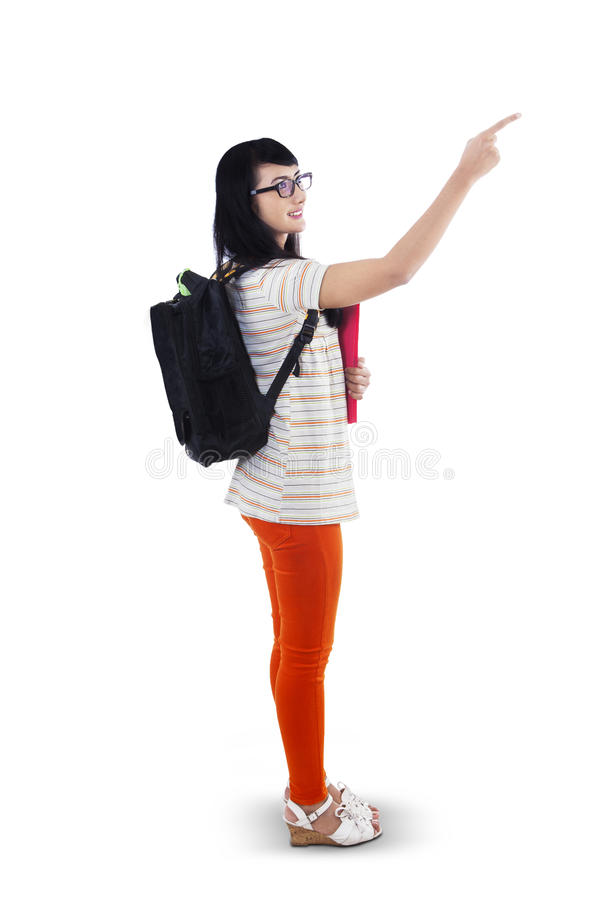 Beautiful student girl pointing up stock image
