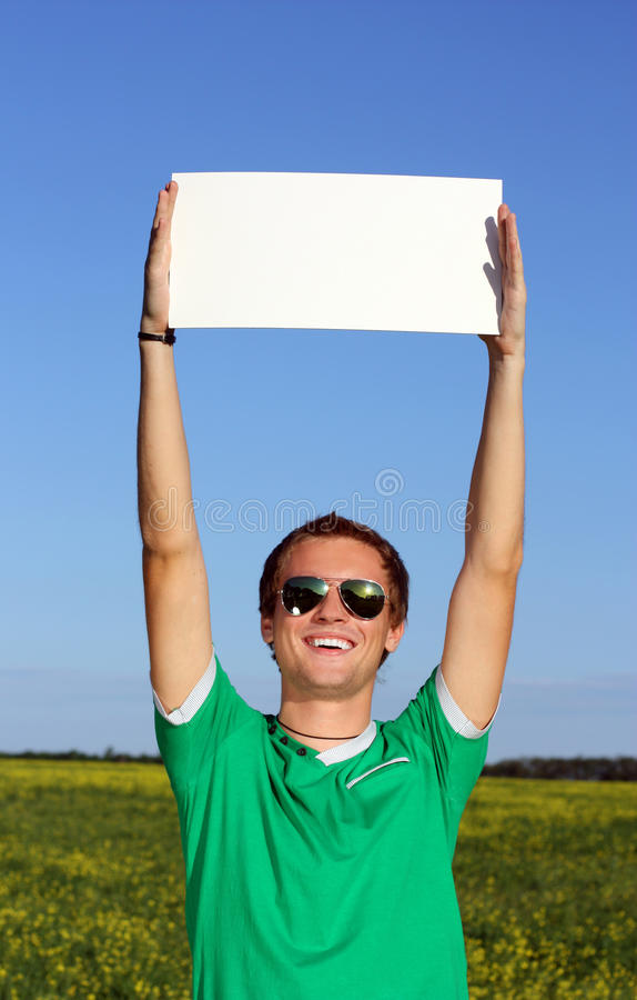 Free Beautiful Student Keeps A Blank Form On The Street Stock Image - 14818161