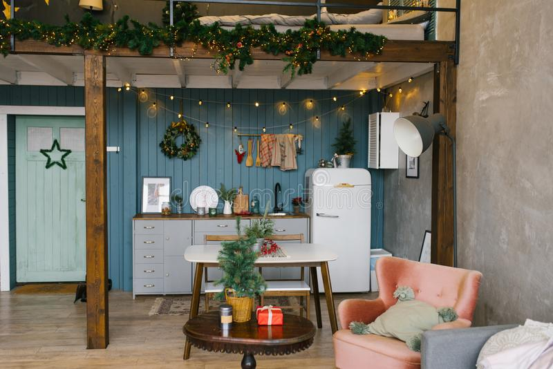 Beautiful Studio apartment in Scandinavian style, decorated for Christmas and New Year, kitchen and table stock image
