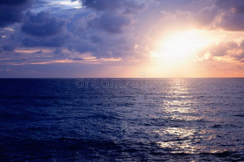Beautiful stunning sunset at the sea, bright natural colors, background and texture stock image