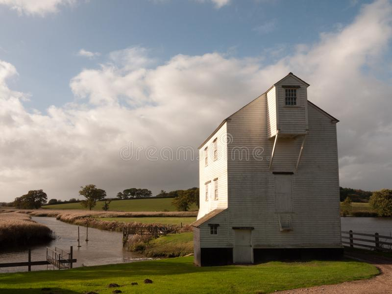 Beautiful stunning white wood slat old farm water river mill house. Essex; england; uk stock image