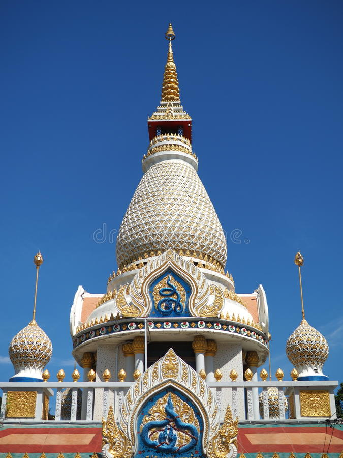 Beautiful stupa soaring into blue sky royalty free stock photography