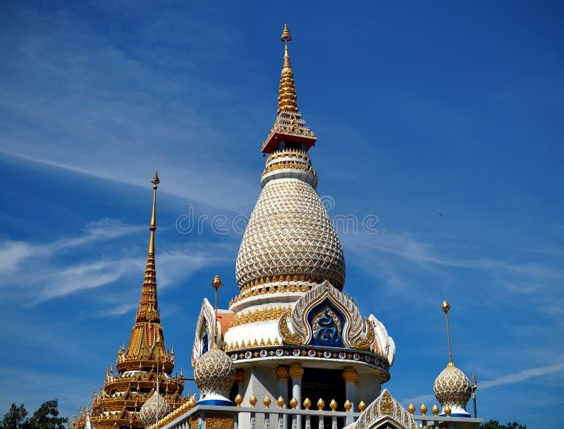 Beautiful stupa soaring into blue sky stock image