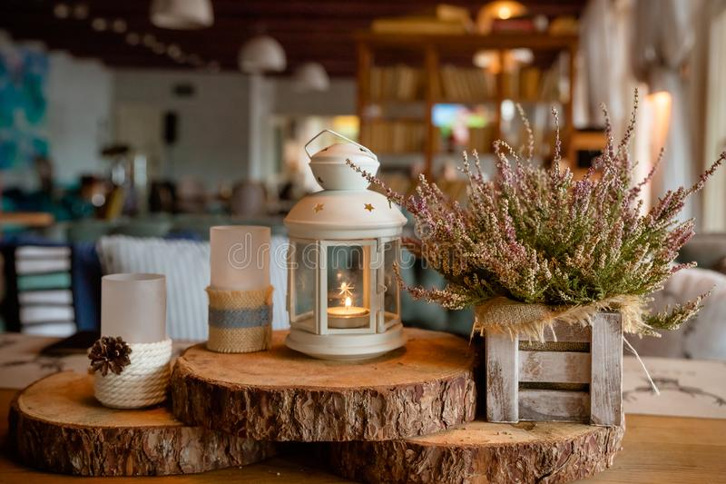 Beautiful stylish autumn table decoration .white - pink heather in autumn basket.Candles and lamps. stylish table. Beautiful stylish autumn table decoration stock photo