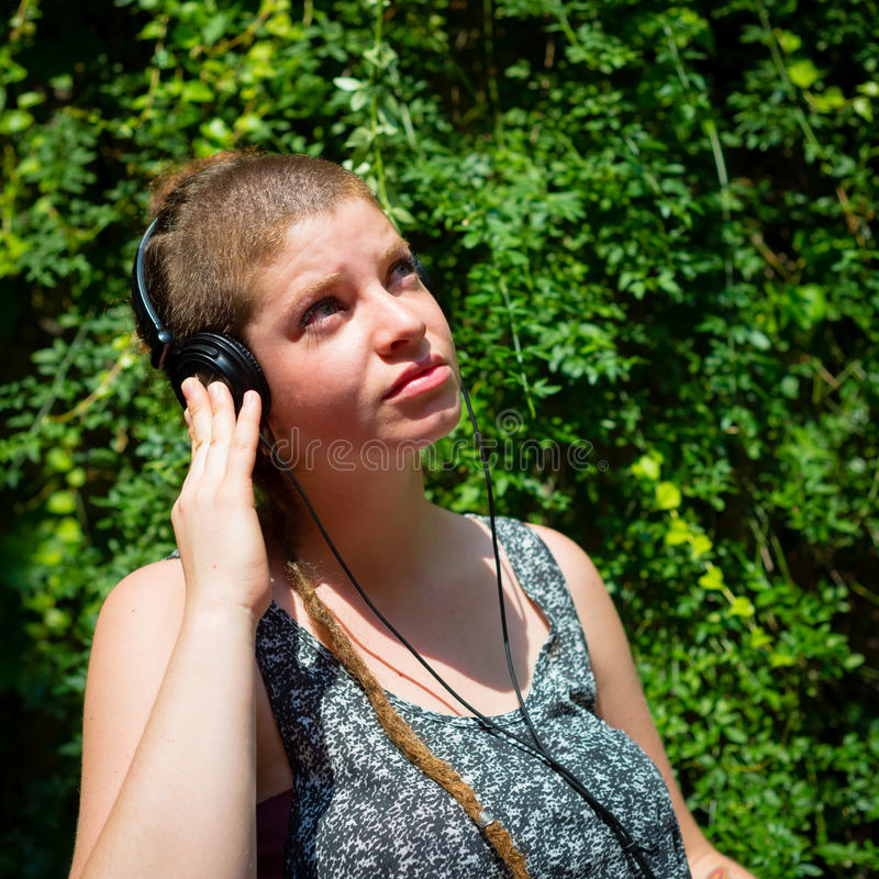Beautiful stylish modern young woman listening to music royalty free stock image