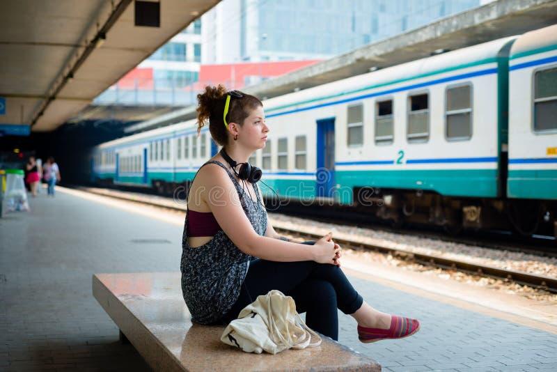 Beautiful stylish modern young woman waiting train stock photo