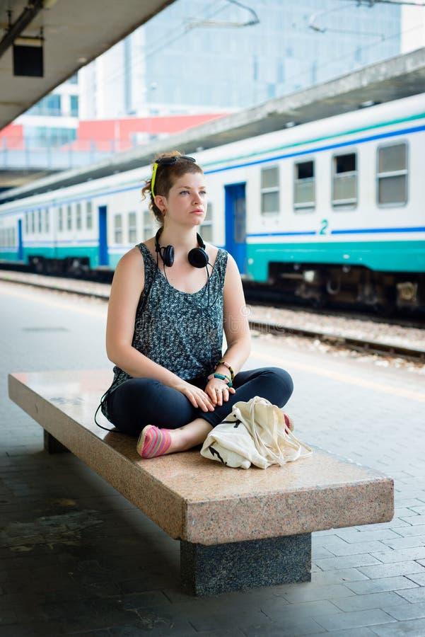 Beautiful stylish modern young woman waiting train stock image