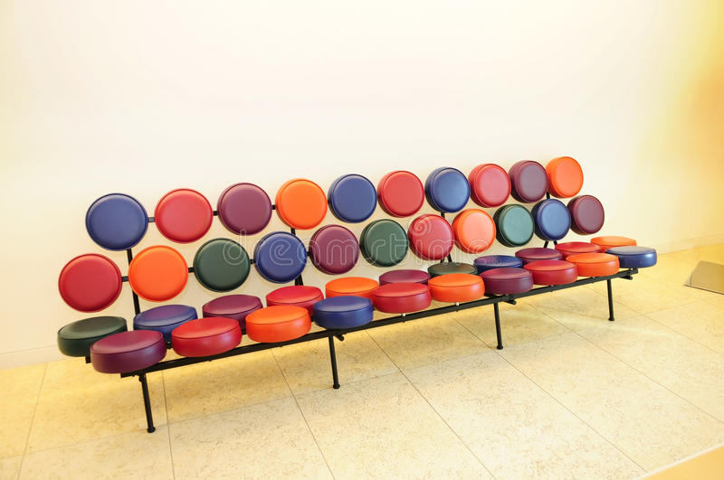 Beautiful and Stylish Sofa. With small round seats in colorful leather stock photos