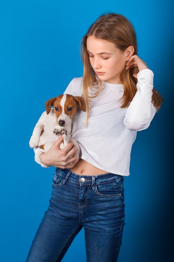 Beautiful stylish teen girl on blue background. royalty free stock photo