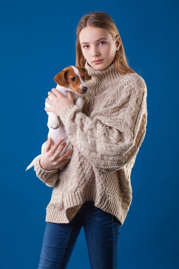 Beautiful stylish teen girl on blue background. stock photo