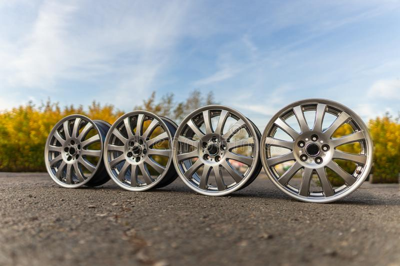 Four Old wheels. Used, outdoors. Summer. stock images
