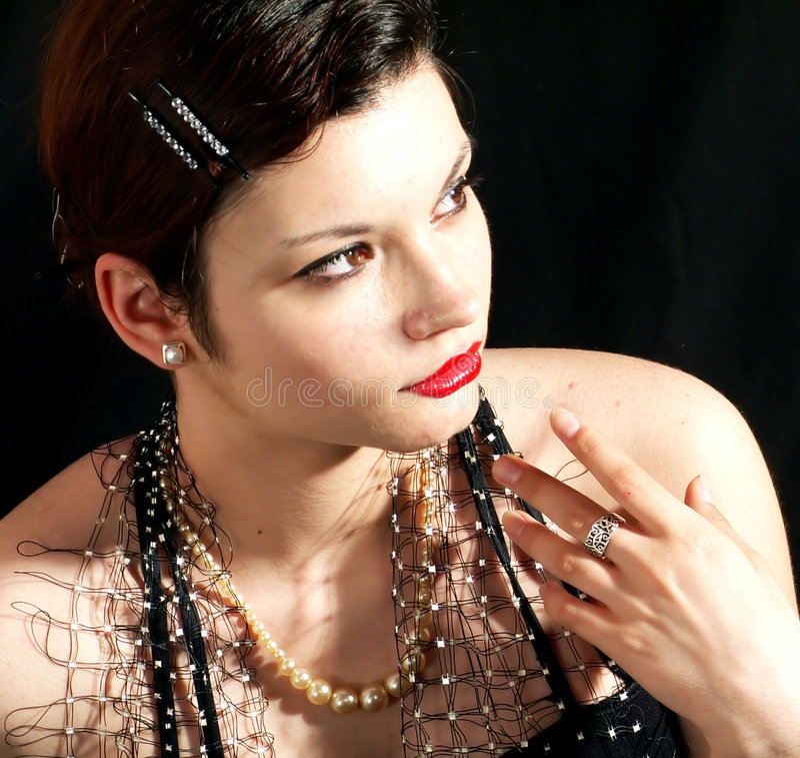 Beautiful stylish woman. Young stylish beautiful woman with vintage look royalty free stock photo