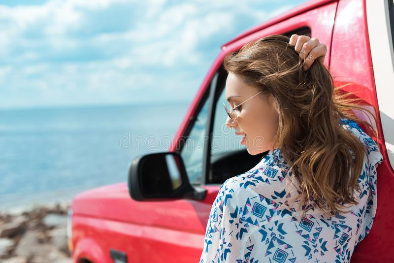 beautiful stylish woman at car during road trip royalty free stock photography