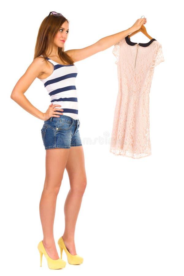 Beautiful, stylish woman choosing dress. stock images