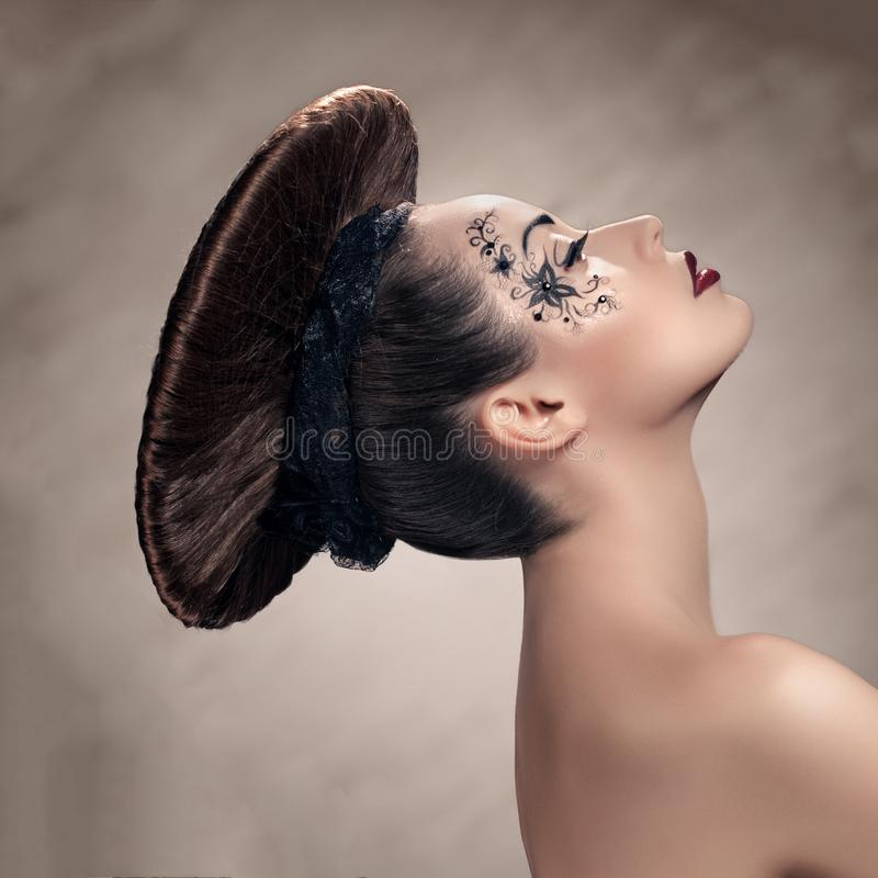 Girl with disc hairstyle. Beautiful stylish woman with disc hairstyle and fantasy make-up royalty free stock photos