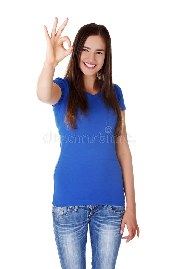 Beautiful success woman giving perfect gesture stock images