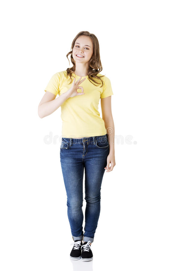 Beautiful success woman giving perfect gesture stock image