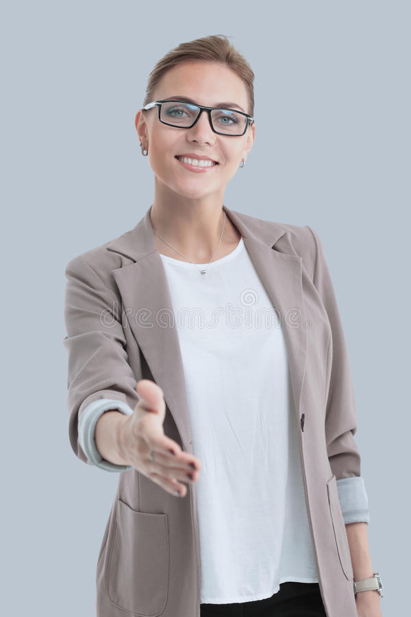 Beautiful successful business woman invites to cooperation isola. Beautiful modern business woman invites to cooperation isolated on gray stock images