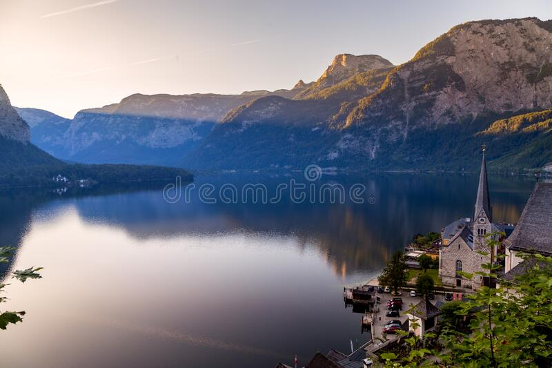 The beautiful summer alpine town of Hallstatt and the mountain lake Hallstatter See at sunrise. Beautiful natural summer stock images