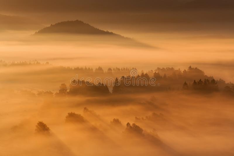 Sunrise Over Misty Landscape. Scenic View Of Foggy Morning Sky With Rising Sun Above Misty Forest. Beautiful summer or autumn sunrise above the forest valley of royalty free stock images