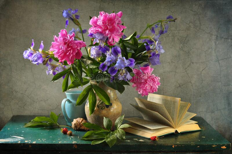 Beautiful summer bouquet with peonies stock photo