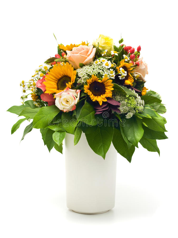 Beautiful summer bouquet in white vase. Beautiful summer bouquet with roses, sunflowers, marguerite daisies and other flowers in a vase, isolated on white stock images